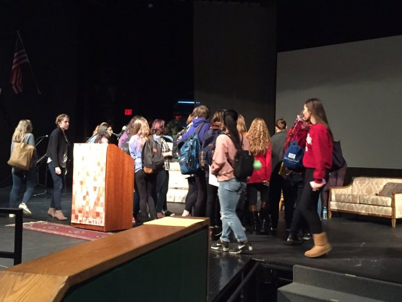 Students running up to meet Andrew McCarty, co-author of